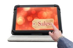 Pantalla del tecleo del finger con la etiqueta en línea de las ventas Fotografía de archivo