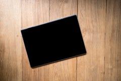 Pantalla en blanco del cuaderno de la tableta Imágenes de archivo libres de regalías