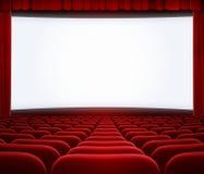 Pantalla grande del cine con la cortina y los asientos rojos Foto de archivo