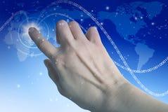 Pantalla táctil de la mano Foto de archivo libre de regalías
