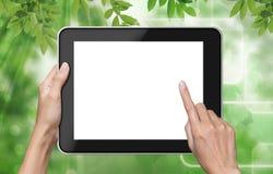 Pantalla táctil de la mano en la PC de la tablilla. Imagenes de archivo