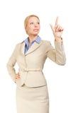 Pantalla táctil de la mujer de negocios con el dedo Imagenes de archivo