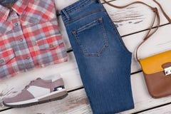 Pantalon de chemise et de denim de flanelle Photo stock
