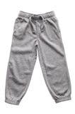 Pantalon de survêtement gris d'isolement Photographie stock