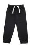 Pantalon de survêtement noir d'isolement Photographie stock