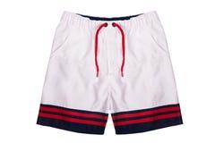 Pantalones cortos blancos con las rayas coloreadas alrededor de los bordes aislados en el fondo blanco Imagen de archivo libre de regalías