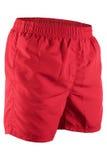 Pantalones cortos de los hombres rojos para nadar Foto de archivo