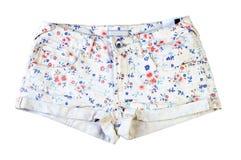 Pantalones cortos de los vaqueros de las mujeres aislados en el fondo blanco Fotos de archivo