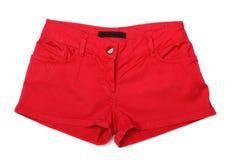 Pantalones cortos femeninos rojos del dril de algodón Fotografía de archivo libre de regalías