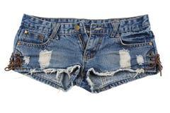 Pantalones cortos llevados viejos de la mezclilla fotos de archivo