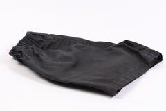 Pantalones cortos negros aislados en blanco fotografía de archivo