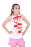 Pantalones cortos que llevan hermosos de la mujer joven y una flor Foto de archivo libre de regalías