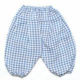 Pantalones del bebé del modelo de las casillas blancas azules y Fotografía de archivo