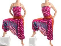 Pantalones multicolores del harén con el modelo indio imagenes de archivo