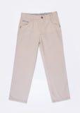 pantalones o pantalones del niño en un fondo foto de archivo