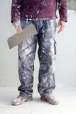 Pantalones sucios del hombre del yeso del yeso de la construcción Imagen de archivo