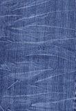Pantalones vaqueros arrugados del dril de algodón Fotografía de archivo libre de regalías