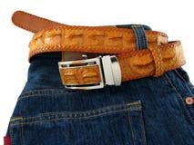 Pantalones vaqueros con la correa del cocodrilo Imagen de archivo