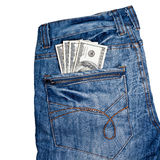 Pantalones vaqueros con los dólares americanos en su bolsillo Fotos de archivo libres de regalías