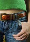 Pantalones vaqueros con una correa Imagen de archivo libre de regalías