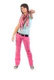 Pantalones vaqueros de la chica joven en pantalones vaqueros rosados rasgados A. Imagen de archivo