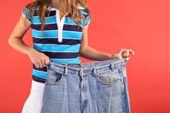 Pantalones vaqueros de la grasa de la pérdida de peso Foto de archivo libre de regalías