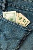 Pantalones vaqueros de los dólares del grupo de los fondos Imagen de archivo libre de regalías