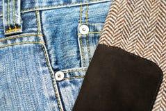 Pantalones vaqueros del dril de algodón y chaqueta de tweed Imagenes de archivo