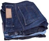 Pantalones vaqueros empilados, aislados Foto de archivo libre de regalías