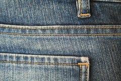 Pantalones vaqueros. La costura. El fondo. 5 Fotografía de archivo