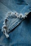 Pantalones vaqueros viejos rasgados Imagenes de archivo