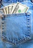 Pantalones vaqueros y dinero Fotografía de archivo