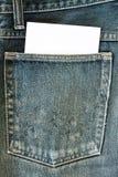 Pantalones vaqueros y papel Foto de archivo libre de regalías