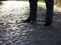 Pantalones vaqueros y zapatos negros Imágenes de archivo libres de regalías