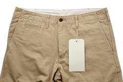 Pantaloni cachi con l'etichettatura Fotografia Stock