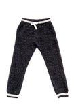 Pantaloni del ` s dei bambini di sport Fotografie Stock