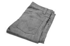 Pantaloni grigi del denim Fotografie Stock