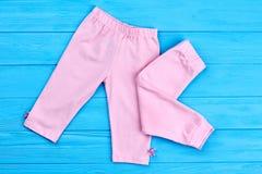 Pantaloni naturali della neonata di marca Immagini Stock