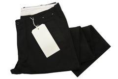 Pantaloni neri con l'etichettatura Immagini Stock Libere da Diritti