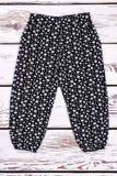 Pantaloni stampati il nero della ragazza del bambino Fotografia Stock