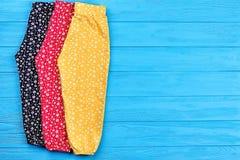 Pantaloni variopinti del bambino, spazio della copia Fotografia Stock Libera da Diritti