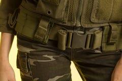 Pantalons militaires et paix de tissu Image stock