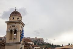 Pantanassa Church on Monastiraki Square, in the city center of Athens, Greece, with the iconic Acropolis in the background Royalty Free Stock Images
