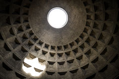 Pantheon dome as seen from inside the Pantheon with a visible light beam coming through the oculus, or open hole. The dome is near Stock Photo