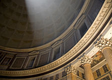 Pantheon Light Ray. A ray of light streams down through the skylight in the Pantheon in Rome Royalty Free Stock Image