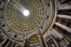 Pantheon, Rome, Italy. Fisheye view. Roman Pantheon's dome and the opening at the top called the Oculus with sun streaming through Stock Photo