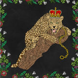 Panther and crown sitting on the trunk with colors and pop art background black Stock Photo
