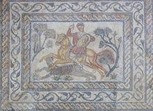 Panther hunter roman  mosaic or Venatio. Merida, Spain - December 20th, 2017: Panther hunter roman  mosaic or Venatio. National Museum of Roman Art in Merida Royalty Free Stock Photos