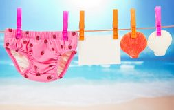 Panties, empty card and scallop on a rope Royalty Free Stock Photography