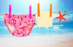 Panties, empty card and starfish on a rope Stock Image